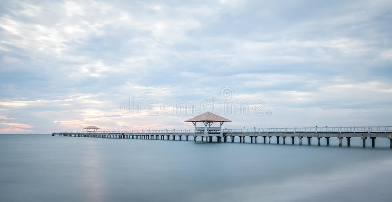 Long wood bridge at sea. In sunset time royalty free stock image