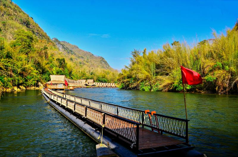 Long wooden bridge of Floating Resort at River kwai , Kanchanaburi Thailand. Background, beauty, beautiful, blue, sky, boat, fishing, forest, green, holiday stock photos