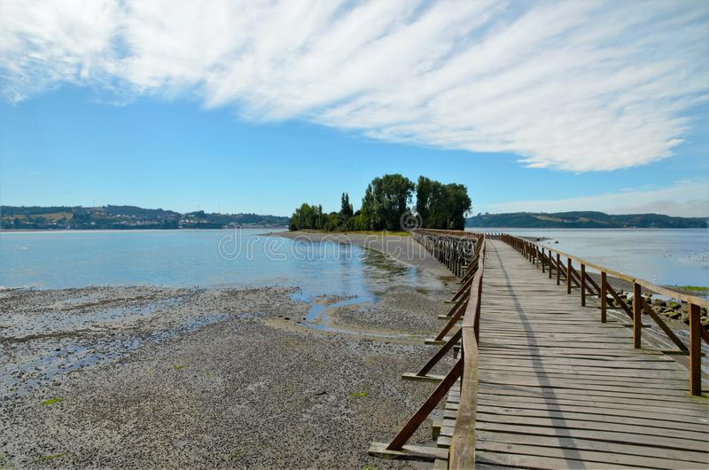 Long wooden bridge to the island Aucar stock images