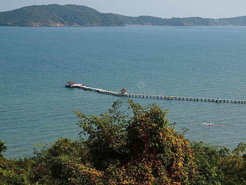 Long Wooden bridge in to the sea stock image