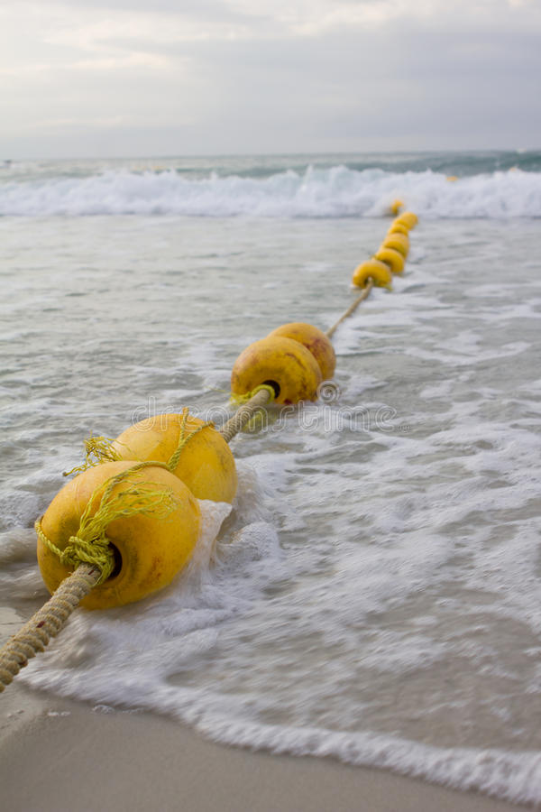 Long Yellow Buoy And Sea Water Stock Photo - Image of