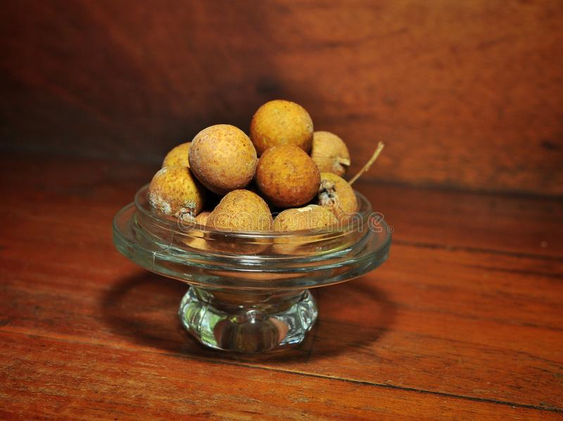 Longan fruits isolated on wood background. Tropical fruit concept.  stock photography