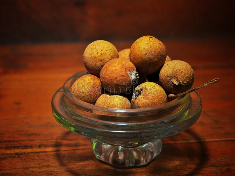 Longan fruits isolated on wood background. Tropical fruit concept.  stock photo