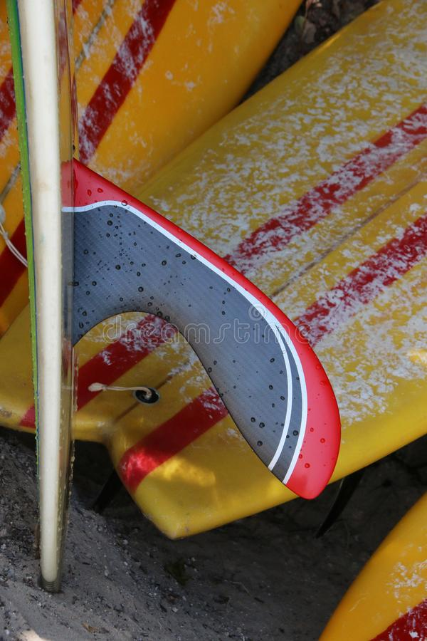 Longboard Fins with Surfboards background stock images