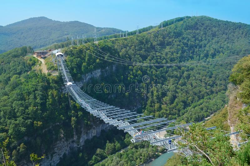 Longest suspended pedestrian bridge across the gorge in Russia. With zip line and the station of extreme sports royalty free stock images