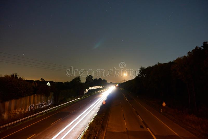 Longexposure picture of a highway. And stars stock photography