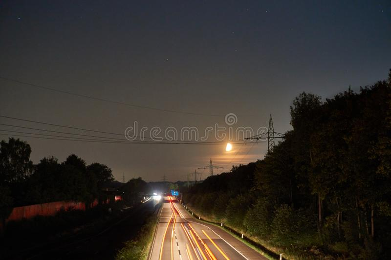 Longexposure picture of a highway. And stars royalty free stock photo