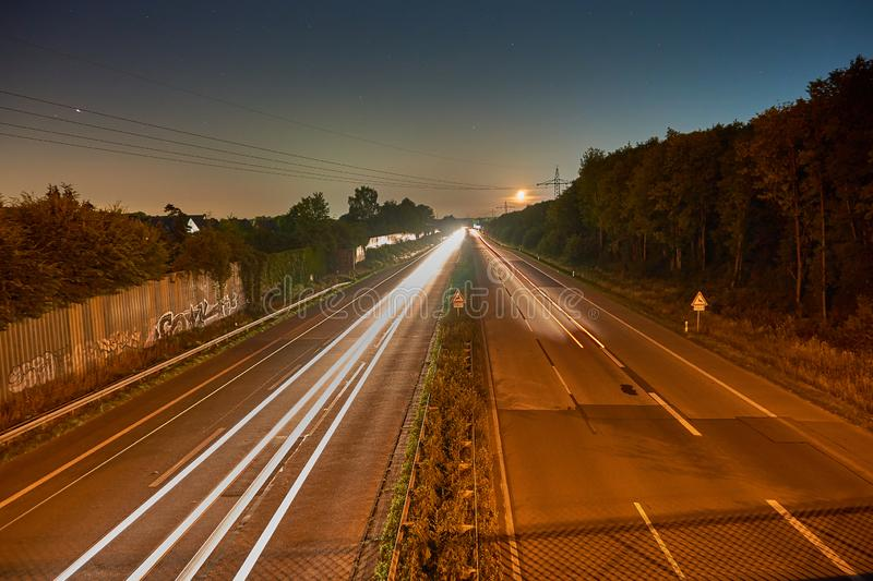 Longexposure picture of a highway. And stars stock photo