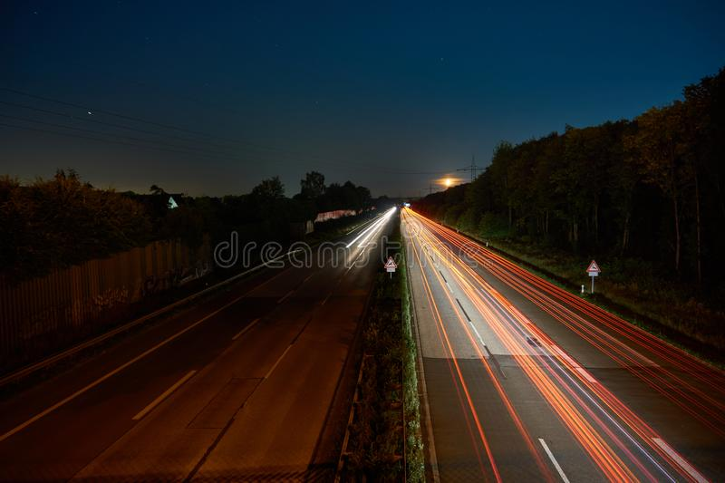 Longexposure picture of a highway. And stars royalty free stock images