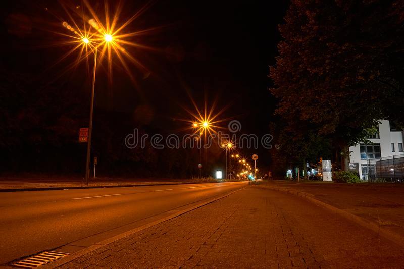 Longexposure picture with a street. And lightrays stock photos