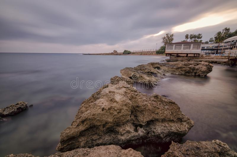 Longexposure sea side. Long exposure in Antalya, with brown rocky seaside and cloudy weather. Longexposure time 4 minutes royalty free stock photo