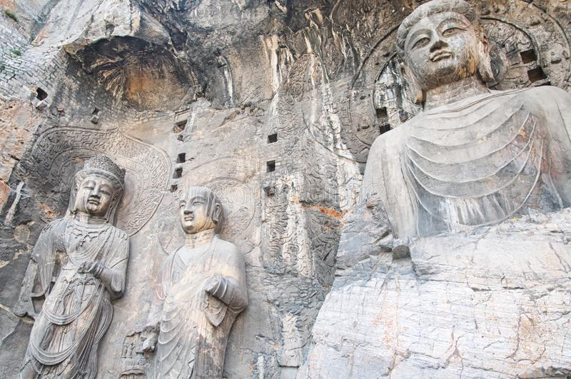 Longmen Grottoes Scenic Area Luoyang China. Ancient Buddha stone statues at Fengxiansi cave at Unesco World Heritage site Longmen grottoes in Luoyang China Henan royalty free stock photos