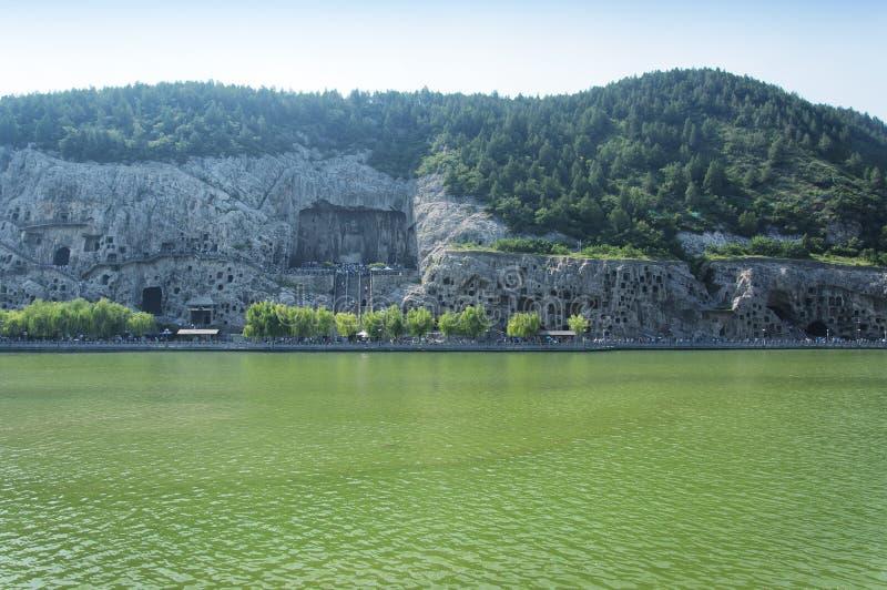 Longmen grottoes scenic area and Yi River Luoyang China. The longmen grottoes scenic area in Luoyang China near the Yi River located in Henan Province stock photo