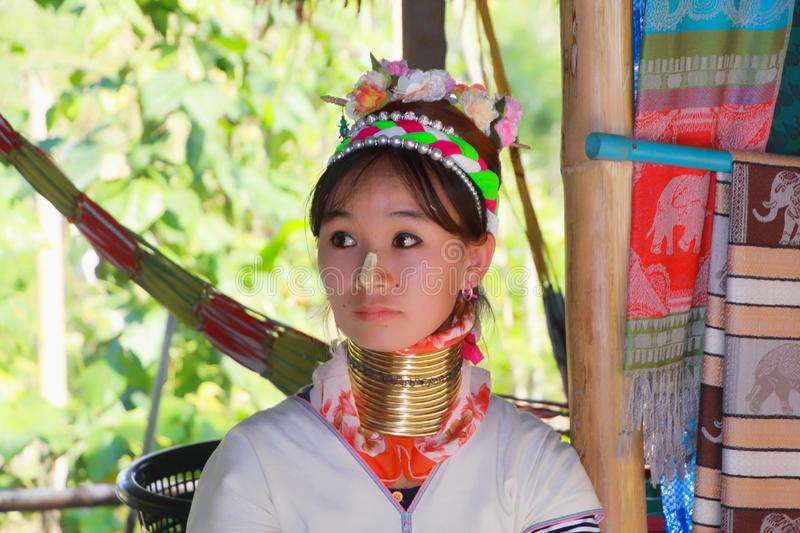LONGNECK KAREN VILLAGE, THAILAND - DECEMBER 17. 2017: Close up of long neck girl with Thanaka face painting and brass neck coil royalty free stock photography