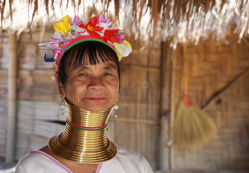 LONGNECK KAREN VILLAGE, THAILAND - DECEMBER 17. 2017: Close up portrait of old long neck woman from Padaung tribe wearing royalty free stock photos