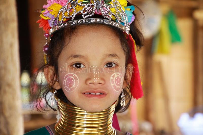 LONGNECK KAREN VILLAGE, THAILAND - DECEMBER 17. 2017: Close up portrait of young long neck girl with Thanaka face painting stock image