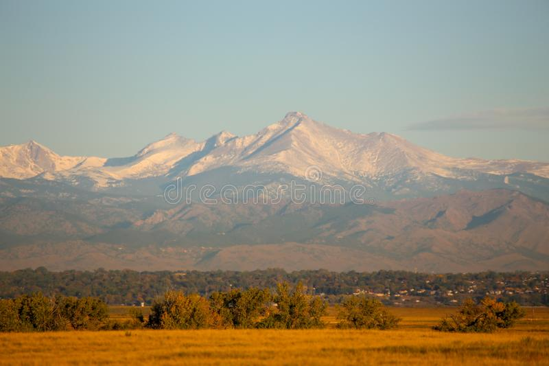 Longs Peak covered in snow from Denver and Commerce City, Colorado royalty free stock photo