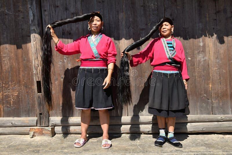 LONGSHENG PING AN, GUANGXI AUTONOMOUS REGION, CHINA – CIRCA JUNE 2016: Portrait of the long hair women from ethnic minority Yao. Portrait of the long hair stock images