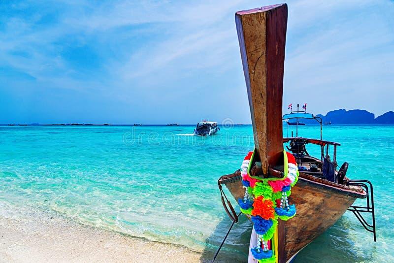 Longtail boat on the sandy beach. Tropical sea stock photo