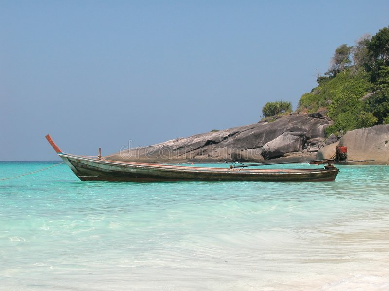 Longtail boat at Similan Island. Longtail motor boat moored at Similan Island, Thailand royalty free stock images