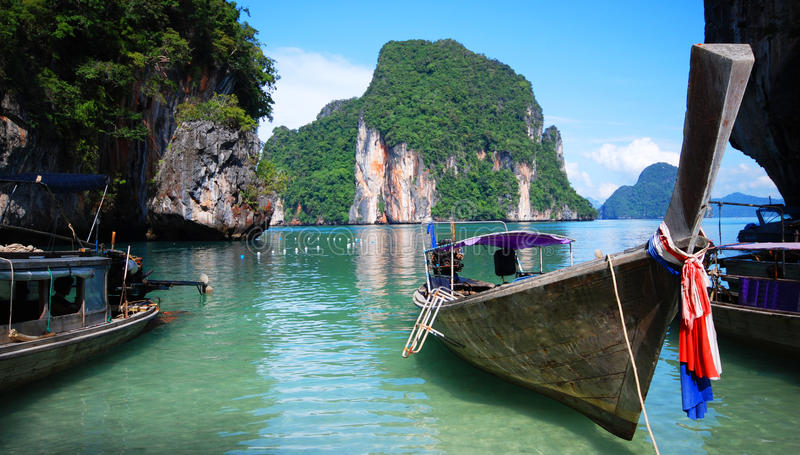 Longtail boats in Thailand. Traditional longtail boats moored on coastline of Thailand