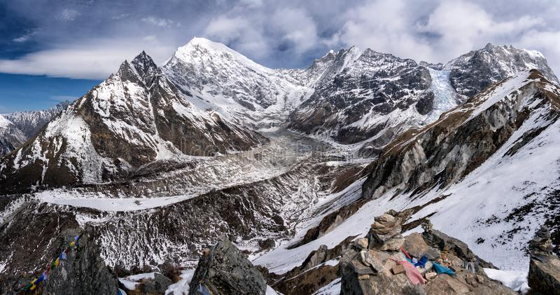 Longtang mountain top view. Mountain views in the morning, clear on the top of the longtang, overlooking the glaciers and the mantra flag of Nepalese people royalty free stock image