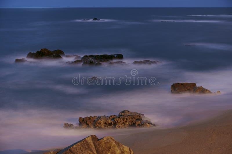 Longue exposition des supports de plage photographie stock libre de droits
