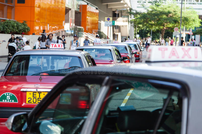 Longue file de Hong Kong Taxis Waiting image stock