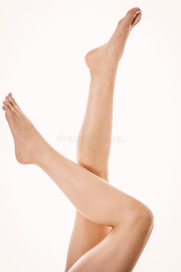 Longues jambes de femme, verticales photo libre de droits