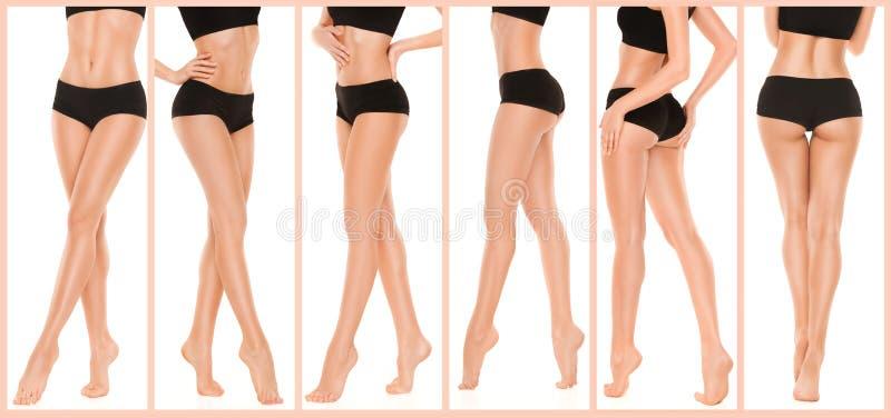 Longues jolies jambes de femme sur le fond blanc photos stock