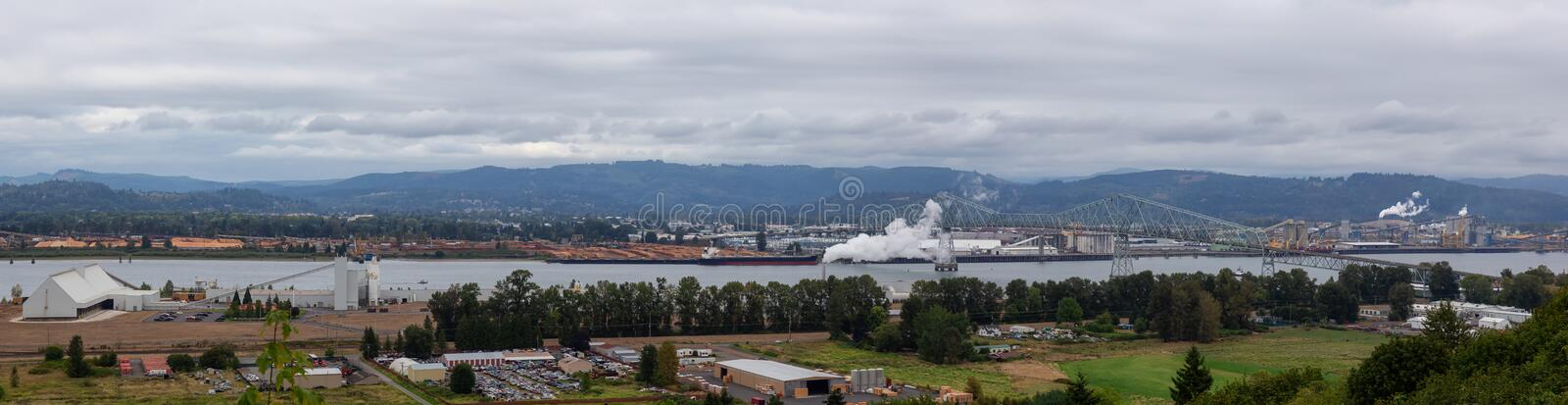 Longview, Washington, United States of America. Aerial Panoramic View of Port, Industrial Sites and Lewis and Clark Bridge over Columbia River stock photo
