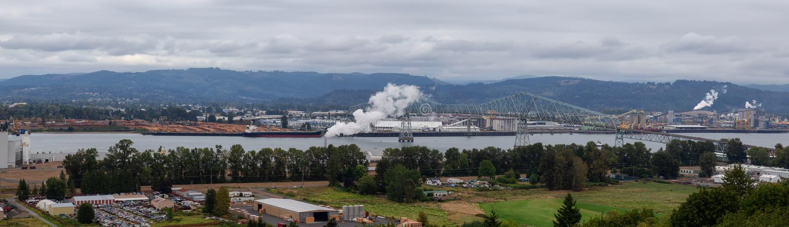 Longview, Washington, United States of America. Aerial Panoramic View of Port, Industrial Sites and Lewis and Clark Bridge over Columbia River stock image
