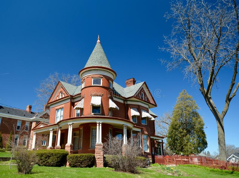 Longworthy Queen Anne. This is a Spring picture of a large house in Dubuque, Iowa. The house built in 1895 is an example of Queen Anne architecture. The house is royalty free stock image