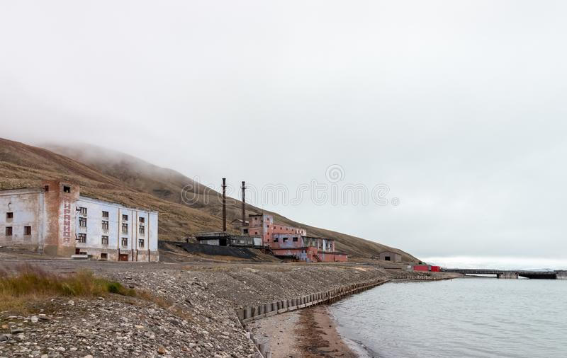 Abandoned power station building at the Russian arctic settlement Pyramiden royalty free stock image