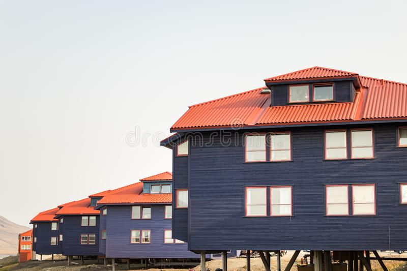 Colorful wooden buildings along the road in summer at Longyearbyen, Svalbard. Longyearbyen, Svalbard, Norway - August 13th, 2018: Colorful wooden buildings along royalty free stock photos