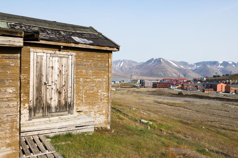 Old wooden house along the road in summer at Longyearbyen, Svalbard. Longyearbyen, Svalbard, Norway - August 13th, 2018: An old wooden houses along the road in stock image