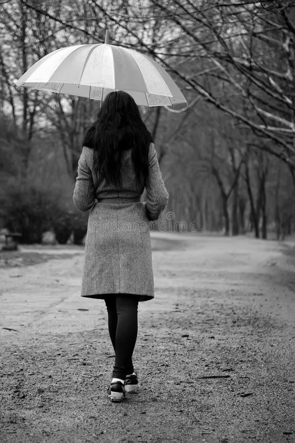 Lonley girl walking at alley royalty free stock photo