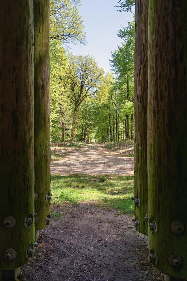 The Loo park located in Apeldoorn, seen between the wooden poles. The Loo park located in Apeldoorn in the Netherlands, een between the wooden poles of a folly royalty free stock images