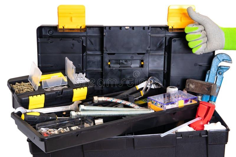 Loodgieter of timmermans geïsoleerde hulpmiddeldoos De zwarte plastic doos van de hulpmiddeluitrusting met geassorteerde hulpmidd royalty-vrije stock afbeeldingen