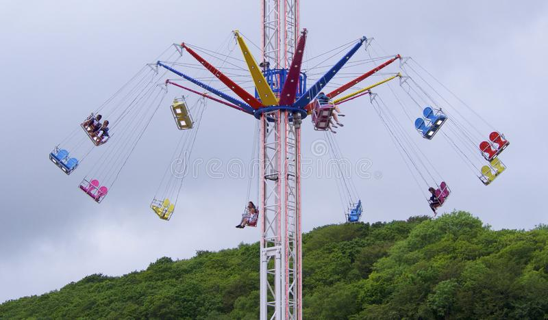 Bank Holiday Weekend Fairground ride. Looe, Cornwall, UK, 05.26.2019  Fairground ride on the Bank Holiday Weekend in overcast weather royalty free stock image