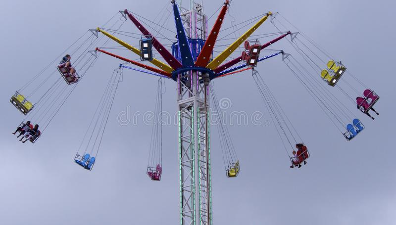 Bank Holiday Weekend Fairground ride. Looe, Cornwall, UK, 05.26.2019  Fairground ride on the Bank Holiday Weekend in overcast weather stock image