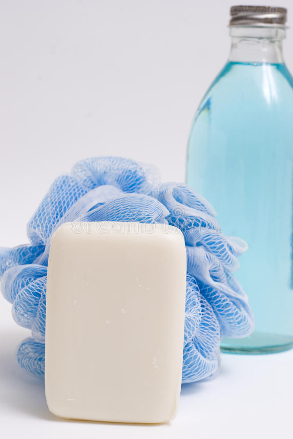 Loofah and soap bottle stock image