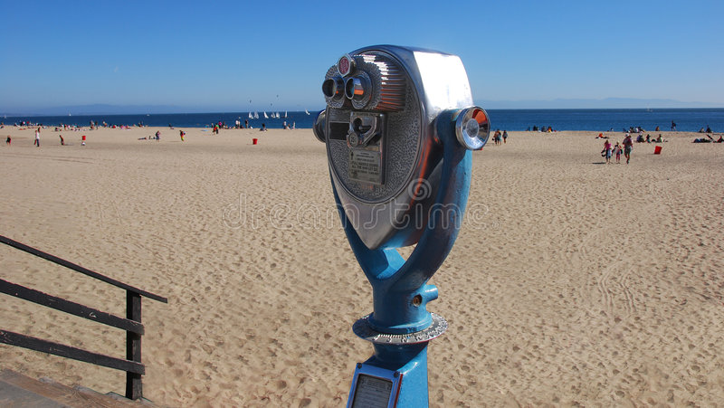 Look for 25 Cents. A pay binocular machine looking over the beach royalty free stock photos