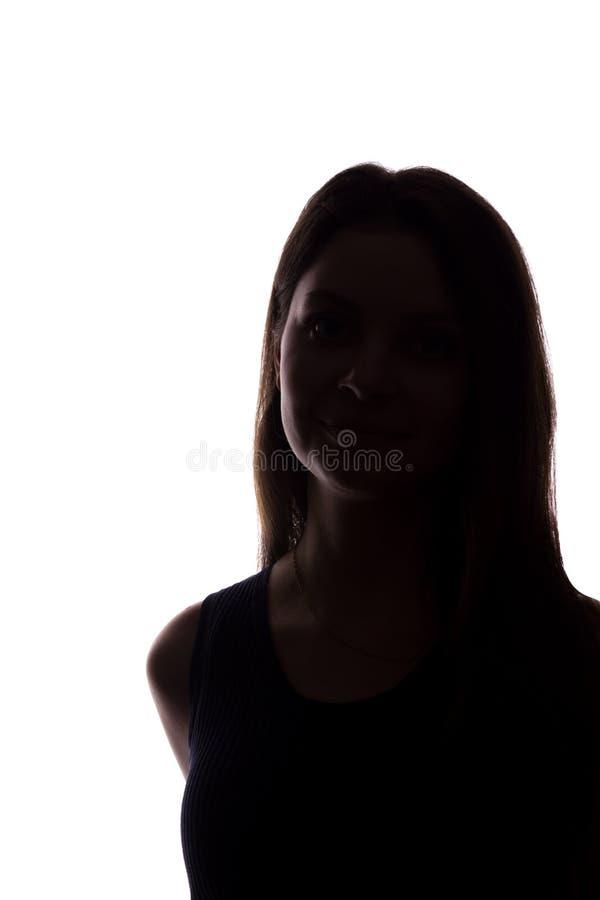 Look ahead de la mujer joven con el pelo que fluye - silueta vertical foto de archivo
