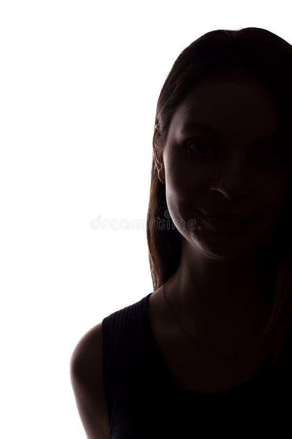 Look ahead de la mujer joven con el pelo que fluye - silueta vertical fotos de archivo