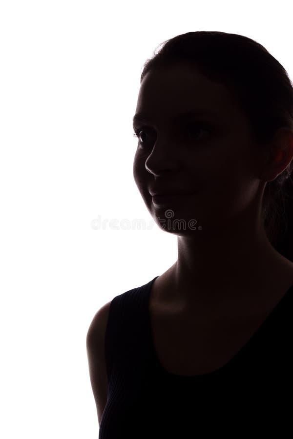 Look ahead de la mujer joven con el pelo que fluye - silueta vertical fotografía de archivo