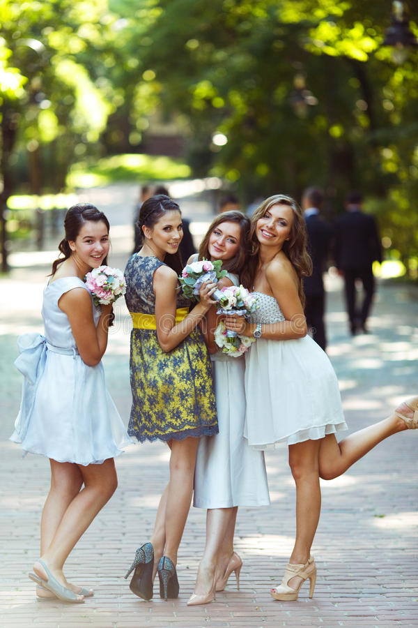 A look from behind on pretty, funny bridesmaids standing in the royalty free stock images