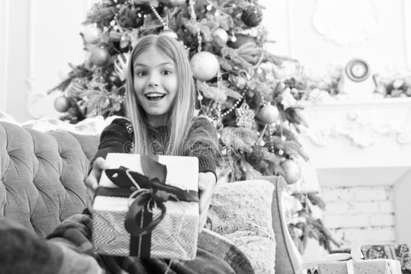 Look at that. Child enjoy the holiday. Happy new year. Winter. xmas online shopping. Family holiday. Christmas tree and. Presents. The morning before Xmas stock photography