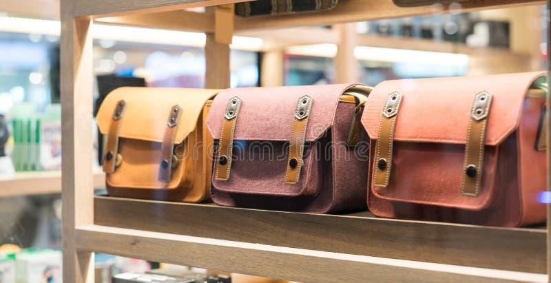 A look through colorful fabric handbag in wood shelf. Selective focus stock photography