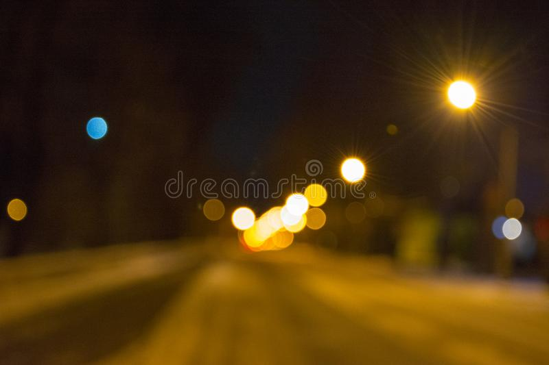 A look at the evening streets through watery eyes royalty free stock photography